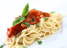 SPAGHETTI WITH TOMATO. Plate of spaghetti whit tomato souse and basilico Royalty Free Stock Image