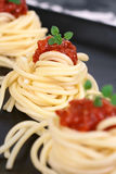 Spaghetti with tomato Stock Images