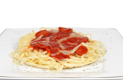Spaghetti with tomato. Sauce on top. The dish is sprinkled with oregano stock photography