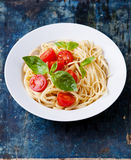Spaghetti with tomato and basil Stock Images