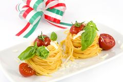 Spaghetti with tomato and basil. Traditional Italian dish, spaghetti with Italian Stock Photos