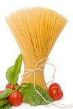 Spaghetti with tomato and basil. On a white background Royalty Free Stock Image