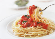 Spaghetti with tomato and basil on fork close up Stock Image