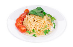 Spaghetti with tomato and basil. Royalty Free Stock Images