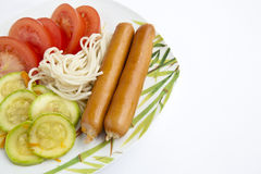 Spaghetti, tomato cabbage , sausage. On a plate isolated on white Stock Image