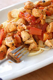 Spaghetti with tomato and chicken meat Stock Photography