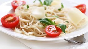 Spaghetti with tomato and parmesan cheese Stock Images
