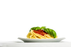 Spaghetti with tomato sauce and basil - horizontal Stock Photography