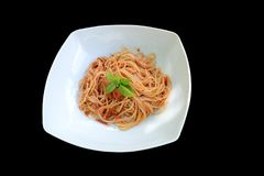 Spaghetti with tomato sauce and basil royalty free stock images