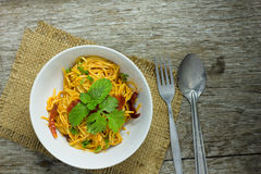 Spaghetti with tomato sauce and Basil in a white bowl on a dark Stock Images