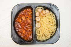 Spaghetti with tomato sauce in black plastic box Royalty Free Stock Image
