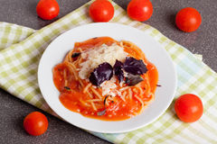 Spaghetti with tomato sauce, cherry tomatoes and cheese Royalty Free Stock Images