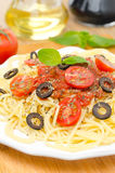 Spaghetti with tomato sauce, cherry tomatoes and olives vertical Royalty Free Stock Photo