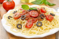 Spaghetti with tomato sauce, cherry tomatoes and olives Royalty Free Stock Photography