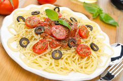 Spaghetti with tomato sauce, cherry tomatoes and olives Stock Image