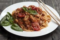 Spaghetti in tomato sauce with chicken stock photo