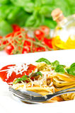Spaghetti with tomato sauce and fresh basil Stock Photos