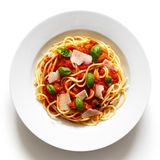 Spaghetti with tomato sauce, fresh basil and cheese. Isolated on Royalty Free Stock Photography