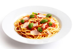 Spaghetti with tomato sauce, fresh basil and cheese.  on Royalty Free Stock Image