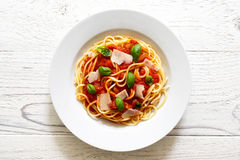 Spaghetti with tomato sauce, fresh basil and cheese. On white wo Stock Images