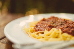The spaghetti with tomato sauce, fried pork chops. Royalty Free Stock Photo