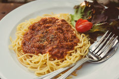 The spaghetti with tomato sauce, fried pork chops. Royalty Free Stock Image