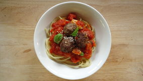 Spaghetti. With tomato sauce, meatballs and fresh basil leaves Royalty Free Stock Images