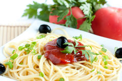 Spaghetti with tomato sauce and olives Stock Image