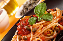 Spaghetti with tomato sauce, olives and capers Royalty Free Stock Photos