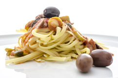 Spaghetti with tomato sauce, olives and capers Stock Photography