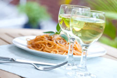 Spaghetti in tomato sauce in an outdoor setting. Stock Photo