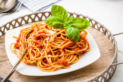 Spaghetti with tomato sauce and Parmesan Stock Photos