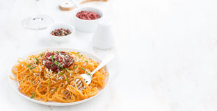 Spaghetti with tomato sauce and parmesan on white wooden table Stock Image