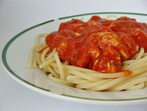 Spaghetti with tomato sauce. Pasta with tomato sauce and chicken bits Stock Photos