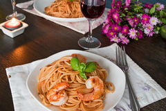 Spaghetti in tomato sauce. Romantic dinner concept Royalty Free Stock Image
