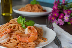 Spaghetti in tomato sauce. Romantic dinner concept Stock Photos