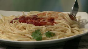 Spaghetti and tomato sauce. Serving spaghetti and tomato sauce stock footage
