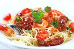 Spaghetti with tomato sauce and shrimps Stock Photos