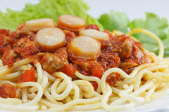 Spaghetti with Tomato Sauce. And Sliced Sausages Stock Photo
