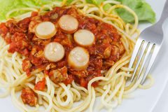 Spaghetti with Tomato Sauce. And Sliced Sausages Stock Photos
