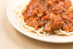 Spaghetti with tomato sauce with spoon and fork Stock Photo