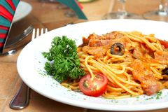 Spaghetti with a tomato sauce on a table in cafe royalty free stock photography