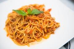 Spaghetti tomato souce with fresh basil. Food Royalty Free Stock Image