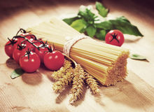 Spaghetti tomato and spices. Italian Cooking. Vintage retro hips Stock Photos