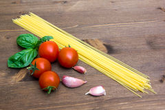 Spaghetti with tomato on wood close up Royalty Free Stock Photography