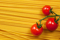 Spaghetti and tomatoes Stock Photos