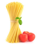 Spaghetti and Tomatoes. Bunch of spaghetti pasta with fresh tomatoes and basil Royalty Free Stock Image