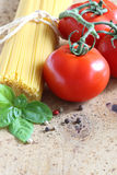 Spaghetti. With tomatoes and basil Stock Photo