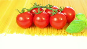 Spaghetti tomatoes and basil background stock video