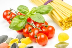 Spaghetti and tomatoes with basil Stock Photos